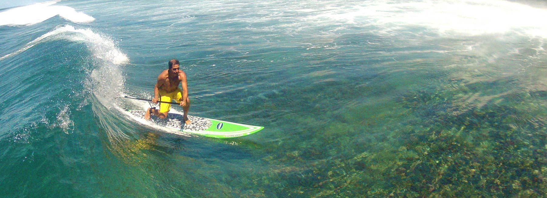 Stand up paddleboarding or SUP at the break in front of the Fiji Beachouse backpacker resort