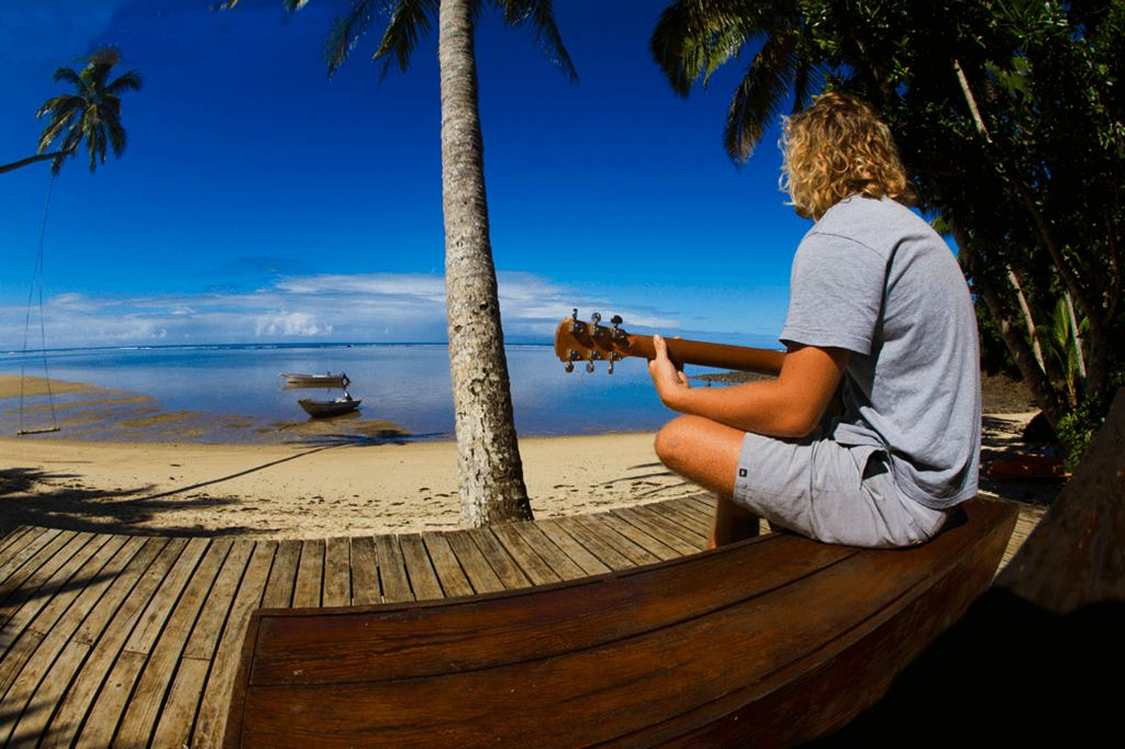 Guitar playing guest at the Fiji Beachouse singing and playing while gazing at the azure ocean